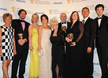 The cast of EastEnders receive the Continuing Drama BAFTA from Chris Addison (BAFTA/Richard Kendal).