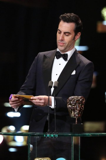 Sacha Baron Cohen presents the award for Leading Actress at the 2016 EE British Academy Film Awards