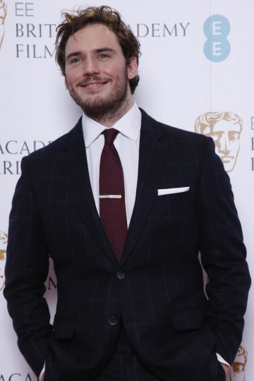 Sam Claflin poses for photos after announcing the nominations for the EE British Academy Film Awards in 2015