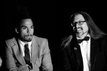 Dev and John Romero get ready to present an award