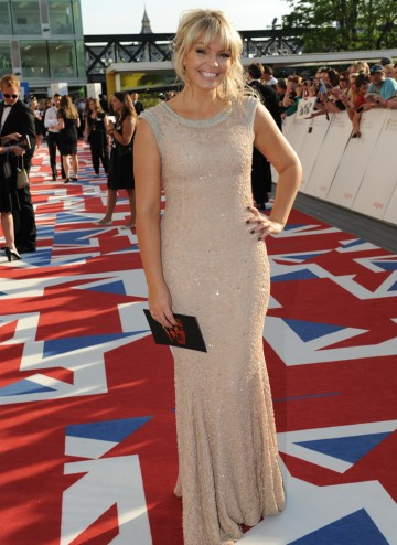 The TV presenter is hosting BAFTA's exclusive red carpet and backstage winners interviews. She wears a gown by Rachel Gilbert and jewellery by BAFTA partner Carat.