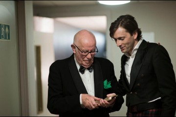Richard Wilson, OBE inspecting his Outstanding Achievement Award in Film with David Tennant