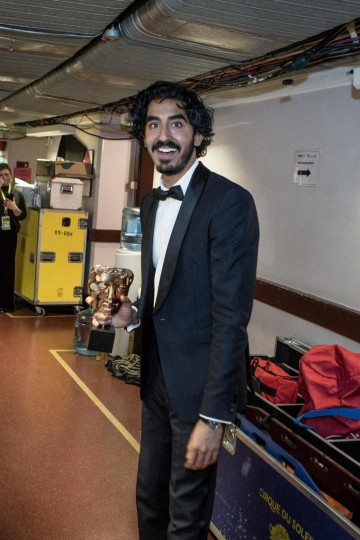 Dev Patel backstage after his win