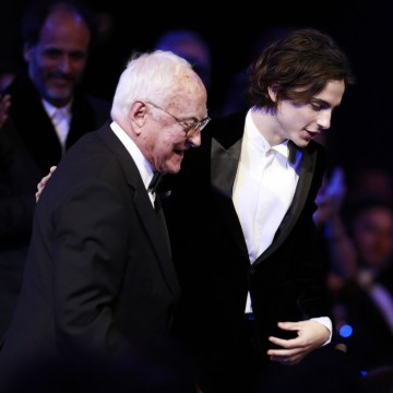 Timothée Chalamet lends a helping hand to Adapted Screenplay winner James Ivory