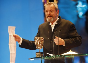 Director and former Monty Python Star Terry Gilliam reads a long list of thank yous as he accepts the BAFTA's highest honour, the Academy Fellowship (BAFTA / Marc Hoberman).