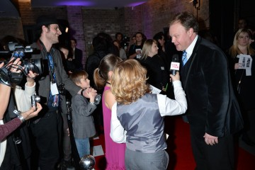 Presenter nominee Justin Fletcher is interviewed by children on the red carpet of the British Academy Children's Awards in 2014