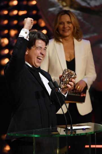 Michael McIntyre fist pumps after winning the award for Entertainment Performance