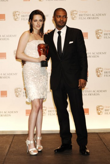 Kristen Stewart celebrates winning the Orange Rising Star Award with the winner in 2009, Noel Clarke (BAFTA/Richard Kendal).