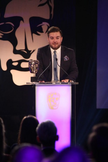Alex Brooker presents the award for Multiplayer at the British Academy Games Awards in 2015