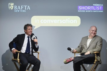 Hugh Grant and Matt Zoller Seitz