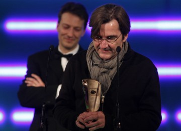 A visibly moved Normand Corbeil, the composer of Heavy Rain's haunting score, accepts the award for Original Soundtrack. (Pic: BAFTA/Brian Ritchie)