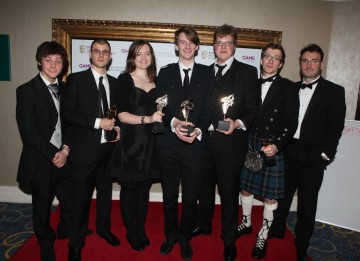 Presenters Tyger Drew-Honey and Jonathan Smith with That Game Studio, aka Jocce Marklund, Annette Nielsen, Linus Nordgren, Marcus Heder, Thomas Finlay, who won for their multiplayer platform racing game, Twang! (Pic: BAFTA/Steve Butler)