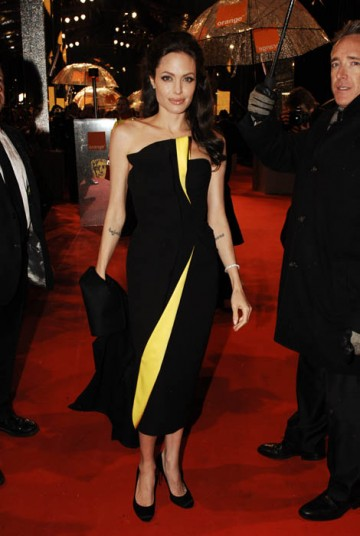 Angelina Jolie, Leading Actress nominee for Changeling, hit the red carpet wearing a striking Armani Prive gown with lemon lightening bolt alongside partner and Leading Actor contender Brad Pitt (BAFTA / Richard Kendal).