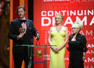 The writing and production team of Eastenders, along with cast members, collect the Continuing Drama Award. (BAFTA/Steve Butler)