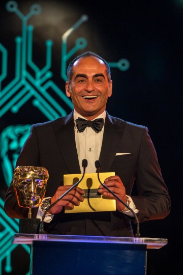Homeland actor Navid Negahban presents the award for Mobile