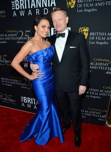 Mad Men's Jared Harris and actress Allegra Riggio strike a pose.