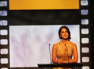 Olivia Munn presented the Albert R. Broccoli Britannia Award for Worldwide Contribution to Entertainment to Will Wright.