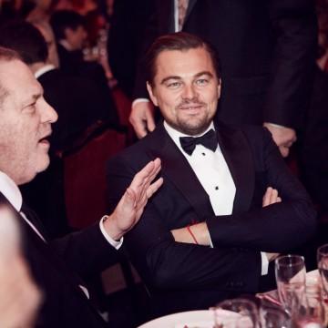 Leonardo DiCaprio enjoys the awards dinner after winning the Leading Actor award at the 2016 British Film Awards