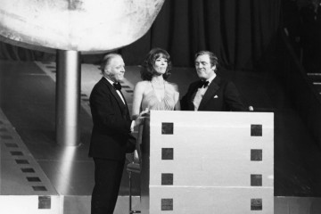 Richard Attenborough on stage with Diana Rigg and Eamonn Andrews at the British Academy Film Awards in 1975.