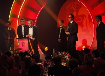 Nick Hall, Luc Houselander, Simon Brickle and Jody Smith pick up the Award for Digital Creativity for their work on Million Pound Drop Live. (Pic: BAFTA/Jamie Simonds)