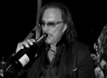 Mickey Rourke celebrates his Leading Actor BAFTA with a bottle of Taittinger champagne (Greg Williams / Art+Commerce).