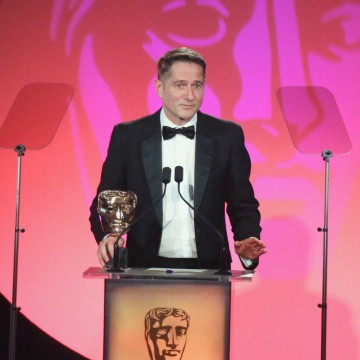 Mike Eley accepts the award for Photography & Lighting: Fiction at the British Academy Television Craft Awards in 2015