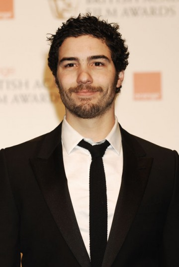Tahar Rahim accepts the award for Film Not in the English Language on behalf of A Prophet (BAFTA/Richard Kendal).