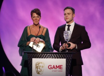 X Factor runner-up Olly Murs and GAME CEO Lisa Morgan present the GAME Award of 2009 as voted for by the British public (BAFTA/Brian Ritchie)