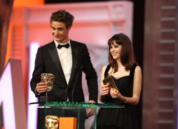 Max Irons (Red Riding Hood) and Felicity Jones (Cemetery Junction) present the BAFTAs for Sound and Editing. (Pic: BAFTA/ Stephen Butler)