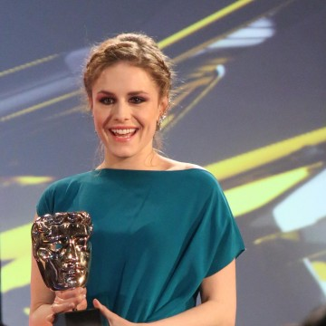 Alix Wilton Regan presents the award for British Game at the British Academy Games Awards in 2015