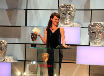 Helen McCrory presents the award for Supporting Actor.