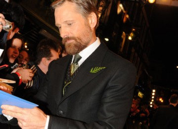 Viggo Mortensen, nominated in the Leading Actor category for his role in Eastern Promises takes the time to sign autographs for waiting fans (pic: BAFTA / Marc Hoberman).