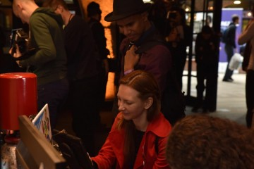 Attendees at the Inside Games Arcade look at a new game