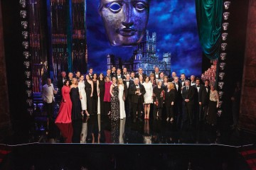 Downton Abbey cast and crew on stage accepting the Special Award at the BAFTA Downton Abbey Tribute event.