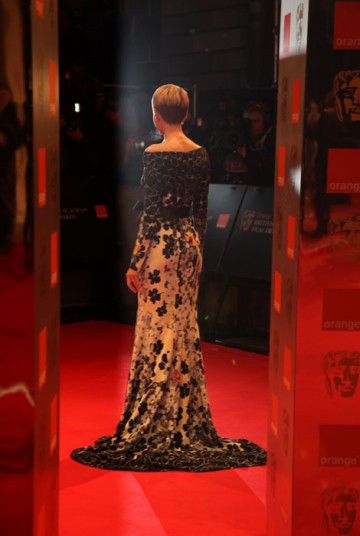 Nominated as Leading Actress for her role in An Education, Carey Mulligan arrives in a flowing Vionnet dress (BAFTA/Richard Kendal).