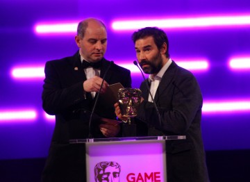 Comedian and DJ Adam Buxton and Philip Oliver (co-founder of Blitz Games Studios) present the BAFTA for Family.