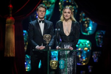 George MacKay and Sophie Turner present the Costume Design Award on stage.