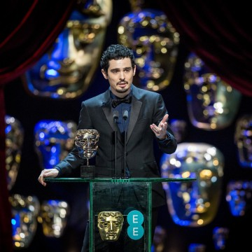 La La Land director Damien Chazelle accepts his award