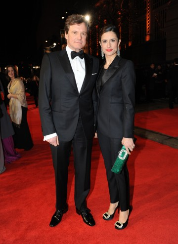 Leading Actor winner of the previous year, Colin Firth in Armani and his wife in a Paul Smith tux with vintage Cartier tassel earrings from 1907 with emeralds and diamonds.