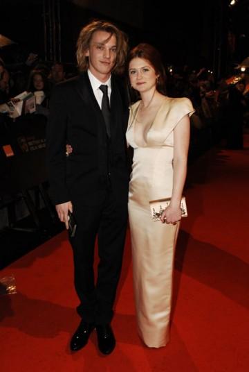 Star of Harry Potter, Bonnie Wright, walks down the carpet in a Prada dress (BAFTA/Richard Kendal).