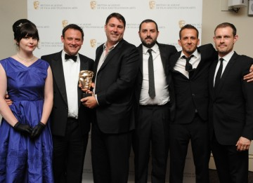 Presenter Ben Price with the winning visual effects team from The Mill, who were also nominated for Doctor Who but won for Merlin. (Pic: BAFTA/Chris Sharp)