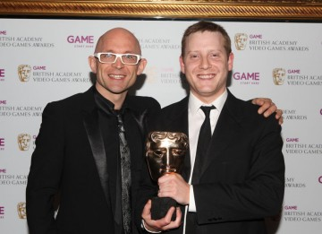 Jason Bradbury and the Mass Effect 2 winner. The RPG was commended for offering a beautiful, complete gaming experience. (Pic: BAFTA/Steve Butler)