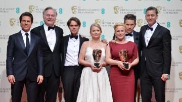 The Boyhood ensemble congregate backstage alongside Tom Cruise with their BAFTA award for Best Film