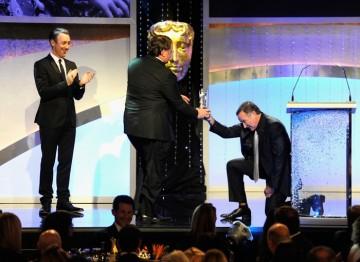 Robin Williams presents John Lasseter with his Britannia Award.