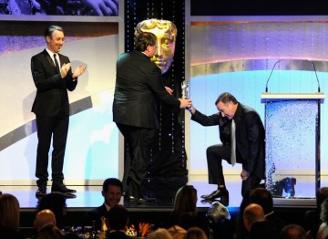 Robin Williams presents John Lasseter with his Britannia Award.