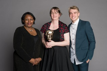 Debbie Moon, winner of the Writer category for Wolfblood at the British Academy Children's Awards in 2014, presented by Children's Laureate Malorie Blackman OBE, with the show's star Bobby Lockwood