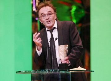 Danny Boyle graciously accepts the Director BAFTA, making it six masks for Slumdog Millionaire (BAFTA / Marc Hoberman).