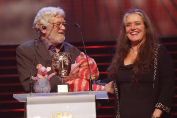 Clangers and Bagpuss designer Peter Firmin collects the Special Award in 2014, and is joined on stage by Bagpuss's Emily