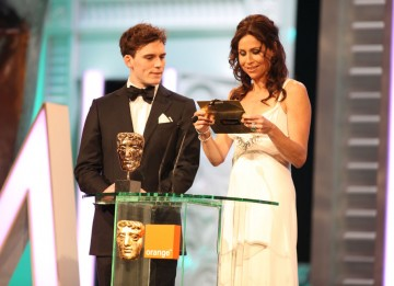 Sam Claflin (Pirates Of The Caribbean: On Stranger Tides) and Minnie Driver (Barney's Version) announce the Production Design winner. (Pic: BAFTA/ Stephen Butler)