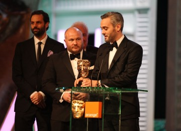 The King's Speech director Tom Hooper, writer David Seidler and producers Iain Canning, Emile Sherman and Gareth Unwin take the Outstanding British Film BAFTA. (Pic: BAFTA/ Stephen Butler)